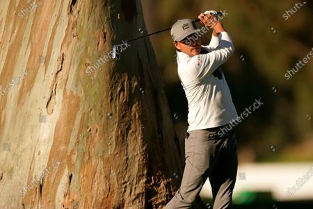 Rickie Fowler hits his second shot on the 11th hole during the second round of the Genesis Invitational golf tournament at Riviera Country Club, in the Pacific Palisades area of Los Angeles