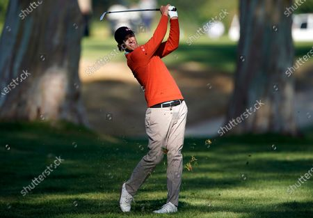 Stock Photo of Adam Scott watches his second shot on the 13th hole during the second round of the Genesis Invitational golf tournament at Riviera Country Club, in the Pacific Palisades area of Los Angeles