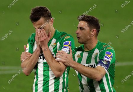 Real Betis' Joaquin Sanchez (R) consoles Sergio Canales (L) after he missed a penalty-kick during the Spanish LaLiga soccer match between Real Betis and Getafe CF held at Benito Villamarin stadium, in Seville, southern Spain, 19 February 2021.