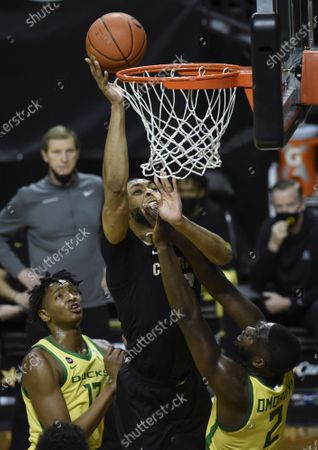 Colorado forward Dallas Walton (13) shoots over Oregon forward Chandler Lawson (13) and Oregon forward Eugene Omoruyi (2) during the first half of an NCAA college basketball game, in Eugene, Ore