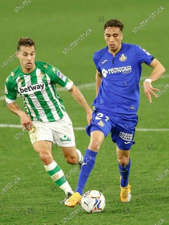 Sofian Chakla of Getafe CF and Sergio Canales of Real Betis