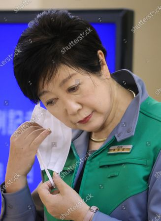 Tokyo Governor Yuriko Koike removes her face mask as she speaks before press at the Tokyo Metropolitan Government office in Tokyo on Friday, February 19 2021. 353 people were infected with the new coronavirus in Tokyo.