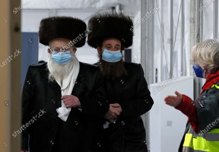 Two men from the Haredi Orthodox Jewish community arrive at an event to encourage vaccinations in Britain's Haredi community at the John Scott Vaccination Centre in London, . The event aims to breakdown some of the misconceptions about vaccines, as well as myths and negative publicity surrounding the Haredi community which has been hard hit during the COVID-19 pandemic