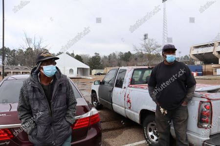 Stock Photo of Veteran Henry Lee Davis and Larry Kelly wait at a city-run water distribution site outside the Smith-Willis Stadium in Jackson on . Both Davis and Kelly had been waiting for more than three hours Friday afternoon. Most of Jackson's 161,000 residents are without power after a week of snow and sub-freezing temperatures