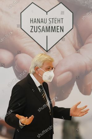 The State Governor of Hesse, Volker Bouffier, gestures under a slogan Hanau stands together' before a memorial ceremony for the anniversary of the shooting by a right-wing extremist. Nine people were killed in two shootings in Hanau on 19 February 2020.