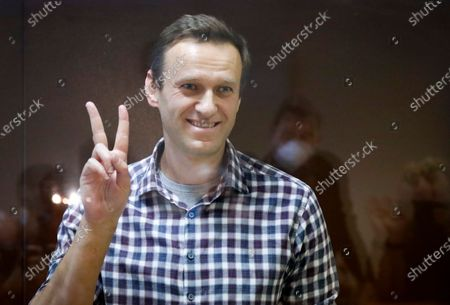 Russian opposition leader Alexei Navalny stands in a cage in the Babuskinsky District Court in Moscow, Russia, . Two trials against Navalny will be held: Moscow City Court will consider an appeal against his imprisonment in the embezzlement case and Babushkinsky District Court will announce a verdict in the defamation case