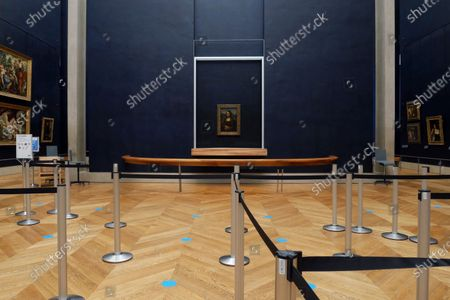 Leonardo da Vinci's Mona Lisa hangs on the wall in a deserted Louvre museum, in Paris, . The 518-year-old Mona Lisa will have seen many things in her life on display, but rarely this: Almost four months with no visitors. She stares out in Paris' Louvre, across bulletproof glass into the now-silent emptiness of the shuttered Salle des Etats