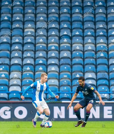 Lewis O'Brien of Huddersfield Town on the ball with Kyle Naughton of Swansea City defending; The John Smiths Stadium, Huddersfield, Yorkshire, England; English Football League Championship Football, Huddersfield Town versus Swansea City.
