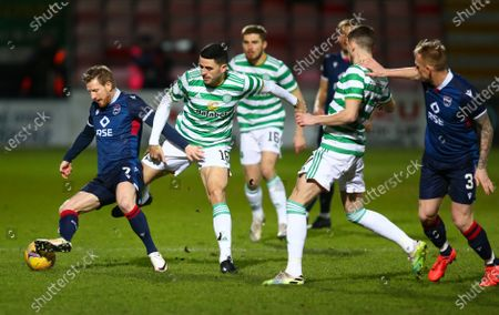 Michael Gardyne of Ross County is challenged by Tom Rogic of Celtic; Global Energy Stadium, Dingwall, Highlands, Scotland; Scottish Premiership Football, Ross County versus Celtic.