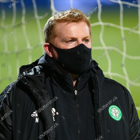 Stock Photo of Celtic Manager Neil Lennon watches his players pre-game; Global Energy Stadium, Dingwall, Highlands, Scotland; Scottish Premiership Football, Ross County versus Celtic.