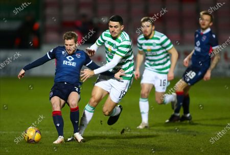 Stock Image of Michael Gardyne of Ross County holds off the challenge of Tom Rogic of Celtic; Global Energy Stadium, Dingwall, Highlands, Scotland; Scottish Premiership Football, Ross County versus Celtic.