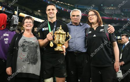 Dan Carter of New Zealand with his parents Neville and Bev Carter, and his older sister, Sarah with the Webb Ellis cup after the Rugby World Cup 2015 Final match between Australia and New Zealand played at Twickenham Stadium, London, on October 31st 2015 Credit: Andrew Fosker / Seconds Left Images