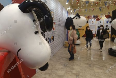 Stock Image of People wearing face masks to help curb the spread of the coronavirus visit the popular cartoon dog Snoopy 70th Anniversary Exhibition in Taipei, Taiwan