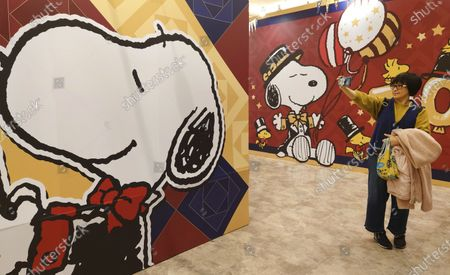 People wearing face masks to help curb the spread of the coronavirus visit the popular cartoon dog Snoopy's 70th Anniversary Exhibition in Taipei, Taiwan