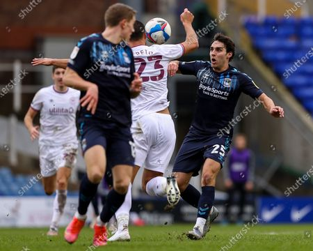 Matt James of Coventry City (on loan from Leicester City) and Winston Reid of Brentford compete for the ball