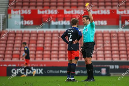 Martin Cranie (2) of Luton Town  gets a yellow card from Referee Robert Jones during the EFL Sky Bet Championship match between Stoke City and Luton Town at the Bet365 Stadium, Stoke-on-Trent