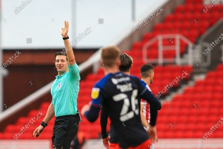 Referee Robert Jones gestures during the EFL Sky Bet Championship match between Stoke City and Luton Town at the Bet365 Stadium, Stoke-on-Trent