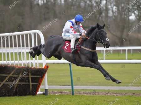 Monmiral and Sean Bowen win the William Hill Extra Places Every Day Juvenile Hurdle at Haydock for owner Sir Alex Ferguson.