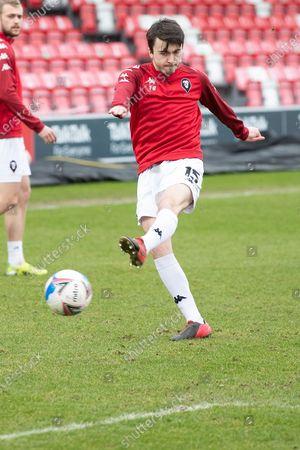 Salford City midfielder Luke Burgess (15) Warming up before the EFL Sky Bet League 2 match between Salford City and Carlisle United at the Peninsula Stadium, Salford
