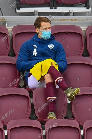 Stock Picture of Substitute Christophe Berra (#6) of Heart of Midlothian FC looks relaxed as he watches from the stand during the SPFL Championship match between Heart of Midlothian and Greenock Morton at Tynecastle Park, Edinburgh