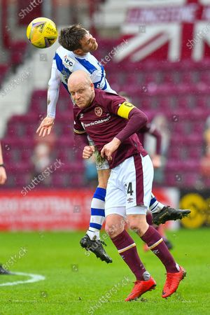 Kyle Jacobs (#6) of Greenock Morton FC wins a header against Steven Naismith (#14) of Heart of Midlothian FC during the SPFL Championship match between Heart of Midlothian and Greenock Morton at Tynecastle Park, Edinburgh