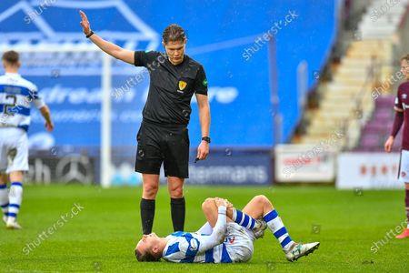 Aidan Nesbitt (#10) of Greenock Morton FC winces in pain, as referee David Dickinson watches on during the SPFL Championship match between Heart of Midlothian and Greenock Morton at Tynecastle Park, Edinburgh