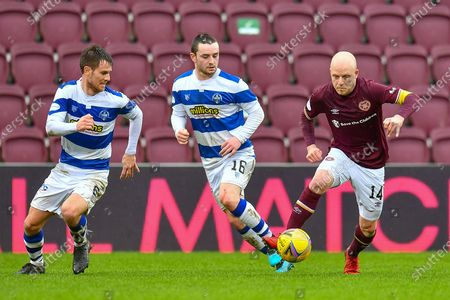 Stock Picture of Steven Naismith (#14) of Heart of Midlothian FC turns inside of Kyle Jacobs (#6) and Lewis Strapp (#16) of Greenock Morton FC during the SPFL Championship match between Heart of Midlothian and Greenock Morton at Tynecastle Park, Edinburgh