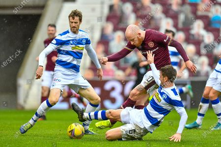 Kyle Jacobs (#6) of Greenock Morton FC tackles Liam Boyce (#10) of Heart of Midlothian FC as he is about the shoot during the SPFL Championship match between Heart of Midlothian and Greenock Morton at Tynecastle Park, Edinburgh