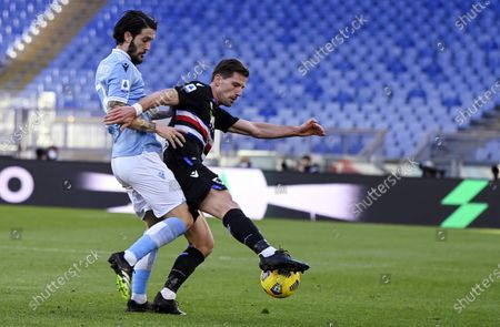 Sampdoria's Adrien Silva (R) in action against Lazio's Luis Alberto (L) during the Serie A soccer match between SS Lazio and UC Sampdoria at the Olimpico stadium in Rome, Italy, 20 February 2021.