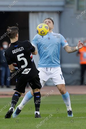Lazio's Ciro Immobile, right, and Sampdoria's Adrien Silva vie for the ball during the Italian Serie A soccer match between Lazio and Sampdoria at Rome's Olympic stadium