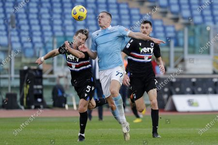 Sampdoria's Adrien Silva, left, and Lazio's Adam Marusic vie for the ball during the Italian Serie A soccer match between Lazio and Sampdoria at Rome's Olympic stadium