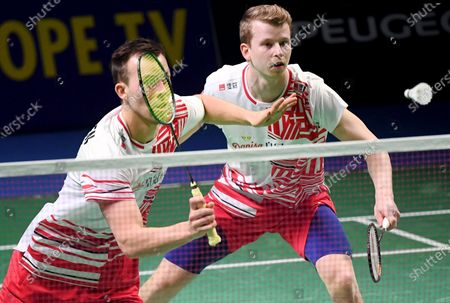 Kim Astrup (R) and Anders Skaarup Rasmussen of Denmark play against Ronan Labar and Julien Maio (not pictured) of France during the Badminton 2021 European Mixed Team Championships final match between Denmark and France in Vantaa, Finland, on February 20, 2021.
