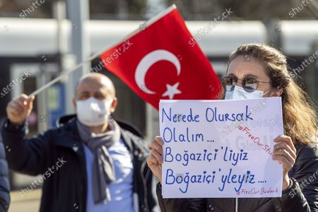 Turks living in Switzerland and supporters shout slogans during a protest against Turkish President Erdogan's appointed rector at the Bogazici University in Ankara, on the place des Nations in front of the European headquarters of the United Nations, in Geneva, Switzerland, 20 February, 2021. Turkish President Recep Tayyip Erdogan appointed a controversial party member as rector of Turkey's highly prestigious Bogazici University. Teachers and students at the Turkish school condemned the new rector's appointment as an undemocratic move.