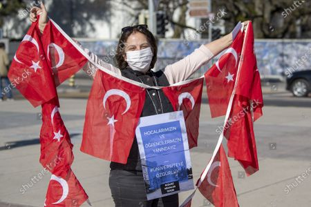 Turks living in Switzerland and supporters during a protest against Turkish President Erdogan's appointed rector at the Bogazici University in Ankara, on the place des Nations in front of the European headquarters of the United Nations, in Geneva, Switzerland, 20 February 2021. Turkish President Recep Tayyip Erdogan appointed a controversial party member as rector of Turkey's highly prestigious Bogazici University. Teachers and students at the Turkish school condemned the new rector's appointment as an undemocratic move.