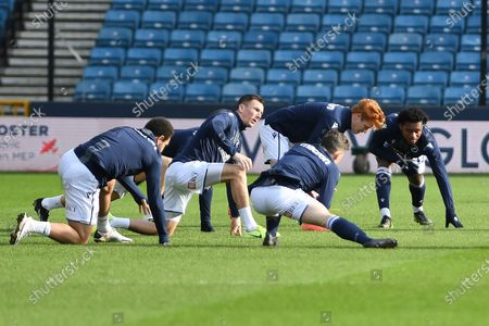 Millwall forward Mason Bennett(20)  Millwall midfielder Jed Wallace(7) Millwall midfielder Ben Thompson(8)  Millwall midfield Ryan Woods(19)  Millwall defender Mahlon Romeo(12) warming up during the EFL Sky Bet Championship match between Millwall and Wycombe Wanderers at The Den, London