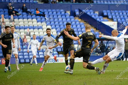 Tranmere Rovers striker James Vaughan (9) shoots during the EFL Sky Bet League 2 match between Tranmere Rovers and Oldham Athletic at Prenton Park, Birkenhead