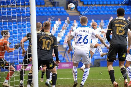 Tranmere Rovers striker James Vaughan (9) headers the ball in the area during the EFL Sky Bet League 2 match between Tranmere Rovers and Oldham Athletic at Prenton Park, Birkenhead