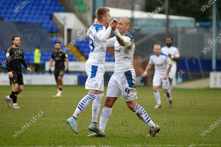 GOAL 1-1! Tranmere Rovers defender Calum MacDonald (18) scores and celebrates with Tranmere Rovers striker James Vaughan (9) during the EFL Sky Bet League 2 match between Tranmere Rovers and Oldham Athletic at Prenton Park, Birkenhead
