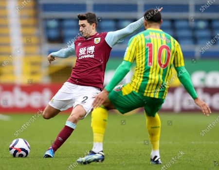 West Bromwich Albion's Matt Phillips, right, challenges Burnley's Matthew Lowton during the English Premier League soccer match between Burnley and West Bromwich Albion at Turf Moor stadium in Burnley, England