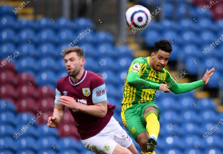 West Bromwich Albion's Matheus Pereira, right, kicks the ball past Burnley's Charlie Taylor during the English Premier League soccer match between Burnley and West Bromwich Albion at Turf Moor stadium in Burnley, England
