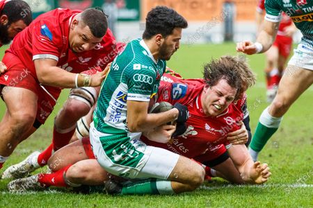 Benetton winger Leonardo Sarto holds Ryan Elias of Scarlets up over the line, preventing a try