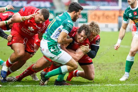 Stock Image of Benetton winger Leonardo Sarto holds Ryan Elias of Scarlets up over the line, preventing a try
