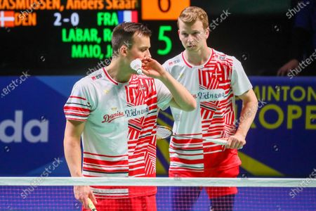 Kim Astrup (R) and Anders Skaarup Rasmussen (L) of Denmark react during the men's doubles match against Ronan Labar and Julien Maio of France for the final tie between Denmark and France final match at the Badminton European Mixed Team Championships in Vantaa, Finland, 20 February 2021.