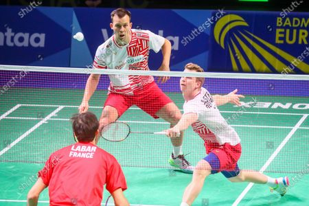 Kim Astrup (R) and Anders Skaarup Rasmussen (L) of Denmark in action during the men's doubles match against Ronan Labar and Julien Maio of France for the final tie between Denmark and France final match at the Badminton European Mixed Team Championships in Vantaa, Finland, 20 February 2021.