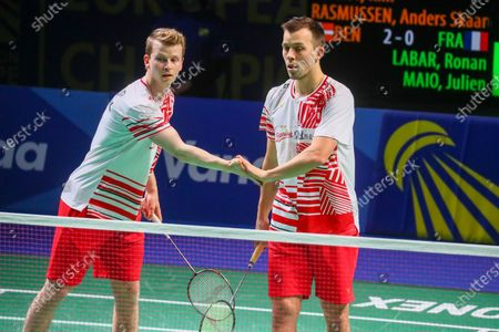Kim Astrup (L) and Anders Skaarup Rasmussen (R) of Denmark react during the men's doubles match against Ronan Labar and Julien Maio of France for the final tie between Denmark and France final match at the Badminton European Mixed Team Championships in Vantaa, Finland, 20 February 2021.