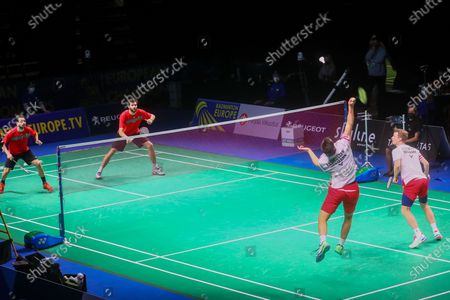 Ronan Labar (2L) and Julien Maio (L) of France in action during the men's doubles match against Kim Astrup(R) and Anders Skaarup Rasmussen(2R) of Denmark for the final tie between Denmark and France final match at the Badminton European Mixed Team Championships in Vantaa, Finland, 20 February 2021.