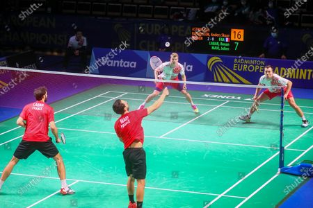 Kim Astrup (2R) and Anders Skaarup Rasmussen (R) of Denmark in action during the men's doubles match against Ronan Labar(L) and Julien Maio(2L) of France for the final tie between Denmark and France final match at the Badminton European Mixed Team Championships in Vantaa, Finland, 20 February 2021.