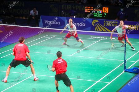 Kim Astrup (2R) and Anders Skaarup Rasmussen (R) of Denmark in action during the men's doubles match against Ronan Labar(L) and Julien Maio (2L) of France for the final tie between Denmark and France final match at the Badminton European Mixed Team Championships in Vantaa, Finland, 20 February 2021.