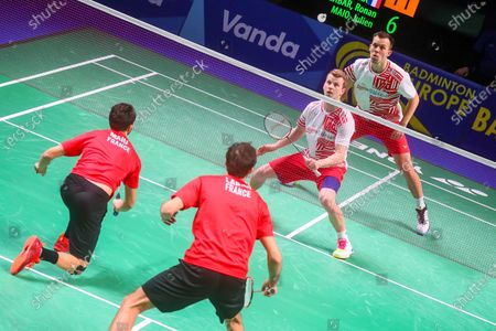 Kim Astrup (2R) and Anders Skaarup Rasmussen (R) of Denmark in action during the men's doubles match against Ronan Labar and Julien Maio of France for the final tie between Denmark and France final match at the Badminton European Mixed Team Championships in Vantaa, Finland, 20 February 2021.