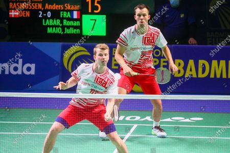 Kim Astrup (L) and Anders Skaarup Rasmussen (R) of Denmark in action during the men's doubles match against Ronan Labar and Julien Maio of France for the final tie between Denmark and France final match at the Badminton European Mixed Team Championships in Vantaa, Finland, 20 February 2021.